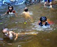 Swim on the river. Children swimming in the river with happy face, at harau waterfall in payakumbuh west sumatra indonesia Royalty Free Stock Photography