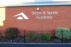 Swim and Sports Academy words. On side of the swimming pool in Burnham on Sea in Somerset, England Stock Images