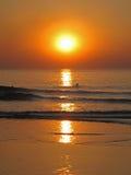 Swim at sunset. Sunset on the Goa beach, India Stock Photos