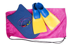 Swim team equiptment on a isolated white background. Swim fins, kick board and goggles on a pink swim bag, isolated white background for high school swim team Royalty Free Stock Photography
