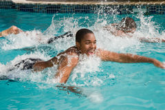 Swim to win in family. Father and teen son in the swimming pool for the big race Stock Images