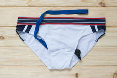 Swim trunks and a whistle for swimmers Royalty Free Stock Photo