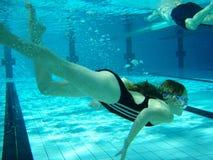 Swim underwater. Swim practice of 8 y.o. girl Stock Photos
