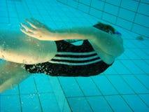 Swim underwater. Swim practice of 8 y.o. girl Stock Photo