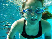 Swim underwater. Swim practice of 8 y.o. girl Royalty Free Stock Photography