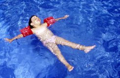 Swim in the water. Kid learn swimmming in a pool Stock Photos