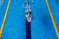 Swim workout. Swimming female training in pool Royalty Free Stock Image