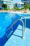 Swimimg pool with stairs at hotel Stock Photo