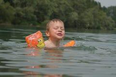 Swiming boy. Happy swiming boy royalty free stock image
