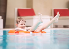 Swiming boy in pool. Swiming boy relaxing  in  pool Royalty Free Stock Photo