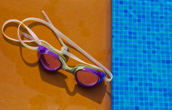 Swiming glasses by pool Stock Photography