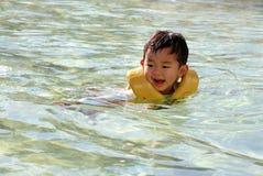 Swiming Japanese boy. (2 years old Royalty Free Stock Photos