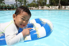 Swiming Japanese boy. (2 years old Royalty Free Stock Image