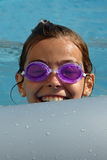 Swiming kid. Young girl in the pool Royalty Free Stock Images