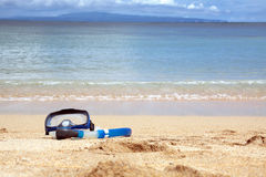 Swiming mask. The island Bali lies on sand on the bank of the Indian ocean Stock Photos