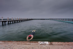 Swiming in ocean pool. A swimmer at an ocean pool on a grey morning Royalty Free Stock Photo