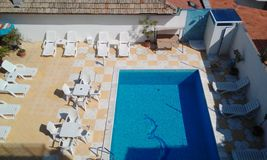 Swiming pool. From above with chairs Royalty Free Stock Image