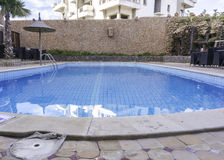 Swiming pool in agadir. Empty blue swimming pool on Morocco propriety Royalty Free Stock Photo