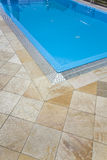 Swiming pool. Close up of a beautiful swimming pool with stones Royalty Free Stock Photography
