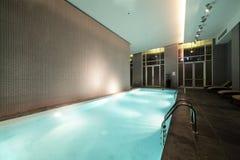 Swiming pool inside building. Beautiful swiming pool inside euporean style building Royalty Free Stock Images