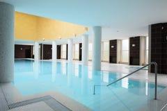 Swiming pool inside building. Beautiful swiming pool inside euporean style building Royalty Free Stock Photography