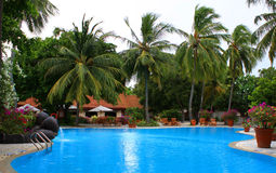 Swiming pool with waterfall maldives Royalty Free Stock Photography
