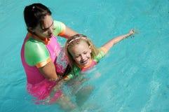 Swimlektion stockbilder