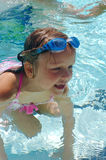 Swimmer. A girl smiling in the pool Royalty Free Stock Image