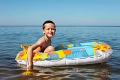 Swimmer. 7 years old boy swimming in the sea - kids royalty free stock photography