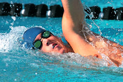 Swimmer. Fierce swimmer in competition at a swim meet stock photography