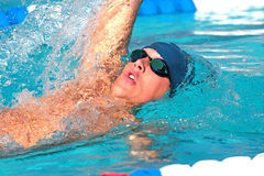 Swimmer. Fierce swimmer in competition at a swim meet Royalty Free Stock Photo