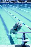 Swimmer. Jumping in the pool Stock Photography
