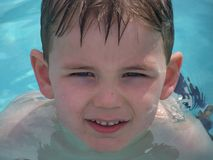 Swimmer. A young boy swims in the pool on a hot day in the sunshine Stock Photography