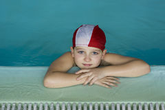 Swimmer. A girl with swimcap on the side of a swimmingpool during swimming lesson Royalty Free Stock Photos