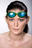 Swimmer. Portrait of a young female swimmer with swimming goggles Royalty Free Stock Photo