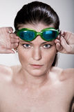 Swimmer. Portrait of a young female swimmer with swimming goggles Stock Photo