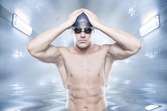 The swimmer. Young swimmer standing in blue water Royalty Free Stock Photography