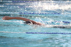 Swimmer. Competes in a high school cometition at the YMCA Stock Image