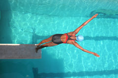 Swimmer. A young girl diving into the pool at a local state diving championship Stock Photo