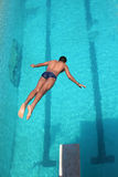 Swimmer. A young man diving into the pool at a local state diving championship Stock Photo