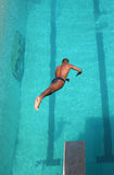 Swimmer. A young man diving into the pool at a local state diving championship Royalty Free Stock Images