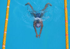 Swimmer. A young girl swimming in the pool at a local state championship Royalty Free Stock Image
