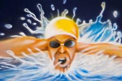 Swimmer. Full effort, graffiti art on the wall airbrush Stock Photography
