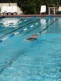 Swimmer. Going underwater Stock Photo