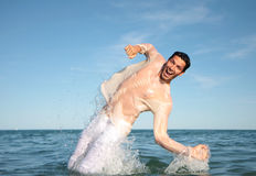 Swimmer. Man diving in to the sea stock images
