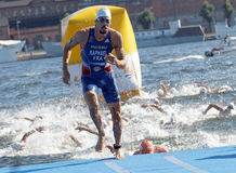 Swimmer Aurelien Raphael (FRA) climbing up from the water. STOCKHOLM - AUG 22, 2015: Swimmer Aurelien Raphael (FRA) climbing up from the water in the Men's ITU Royalty Free Stock Photography