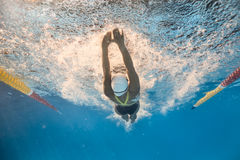 Swimmer in back crawl style underwater Royalty Free Stock Images