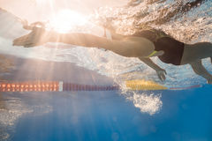 Swimmer in back crawl style underwater Stock Photography