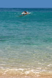 Swimmer in a bay of St. Barth, Caribbean Stock Image