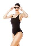 Swimmer in black swimwear and glasses Stock Photos